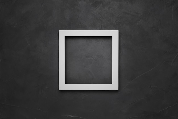 Marco vacío cuadrado blanco sobre fondo gris con textura con copyspace Foto gratis