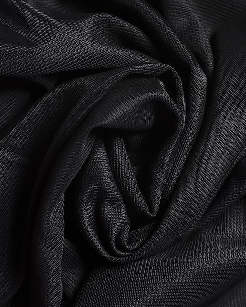 Material elegante negro de seda con curvas Foto gratis
