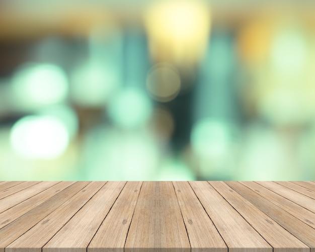 e37b382c1 Mesa de madera vacía en el fondo borroso