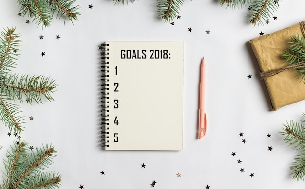 Metas planes sueños hacer lista de tareas para año nuevo 2018 navidad concepto escrito Foto gratis
