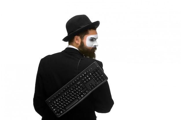 Mime como hombre de negocios con un teclado Foto gratis