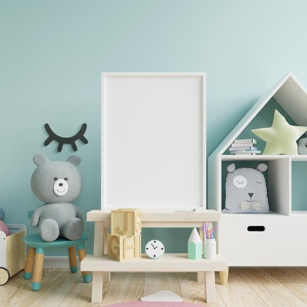 Mock up marco de póster en la habitación de los niños, sala de niños, maqueta de guardería, pared azul. Foto Premium