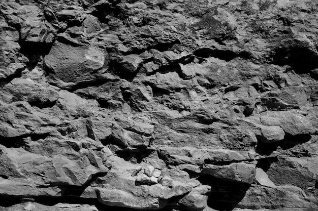 Monocromo cara de la roca Foto gratis