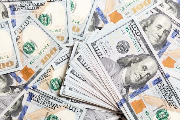 Montón de billetes de dólar estadounidense, fondo de dinero Foto Premium