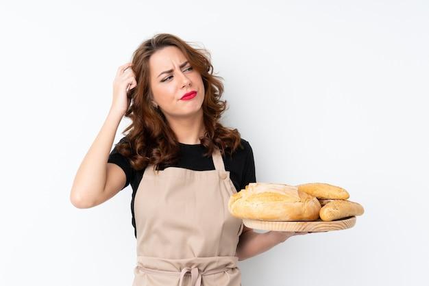 Mujer baker sobre pared aislada Foto Premium