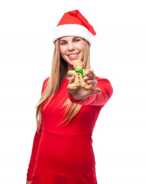 Mujer con una galleta de persona y el sombrero de papa noel ... 7285b470273