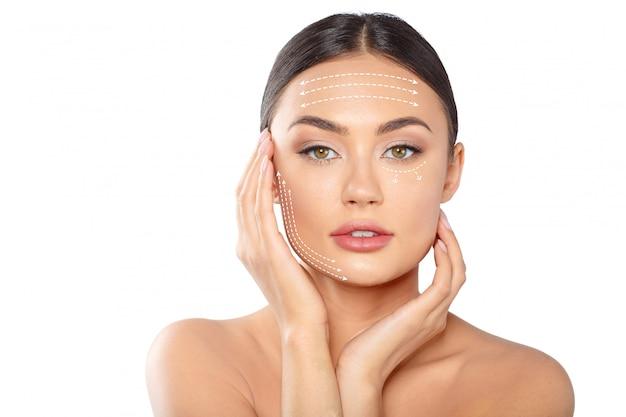 Mujer con líneas punteadas en la cara Foto Premium