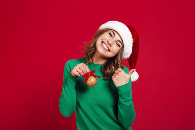 Mujer, llevando, navidad, sombrero de santa Foto gratis