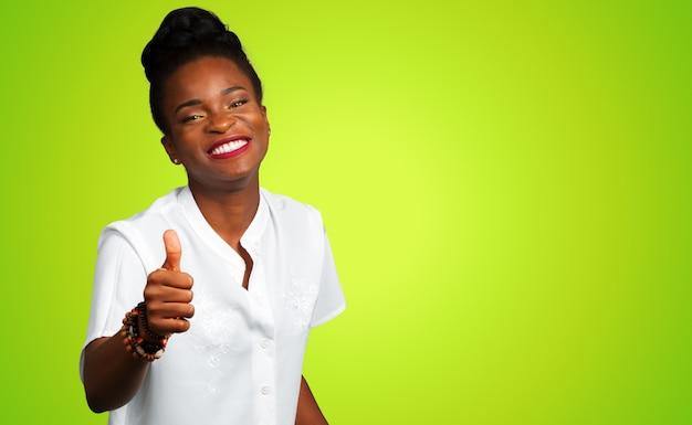 Mujer de negocios afroamericano con los pulgares para arriba Foto Premium