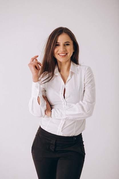 Mujer de negocios en la camisa blanca aislada en el fondo blanco Foto gratis