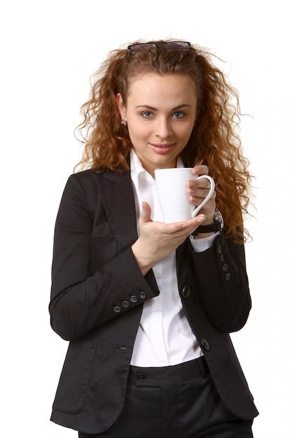 Mujer de negocios con taza de té Foto Premium