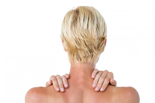 Mujer teniendo dolor en el hombro - Foto Premium