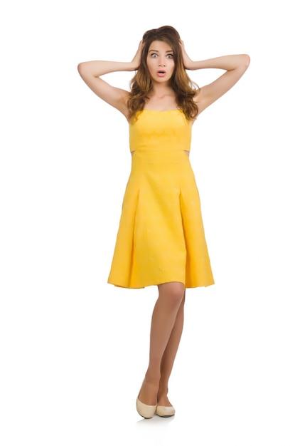 33363b126 Mujer en vestido amarillo aislado en blanco | Descargar Fotos premium