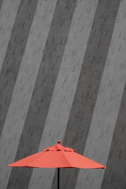 Muro de hormigón de un edificio con un paraguas rojo Foto gratis