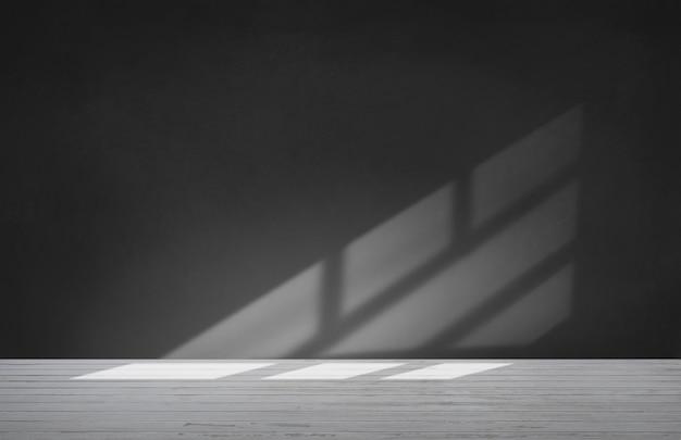 Muro negro en una habitación vacía con piso de concreto Foto gratis