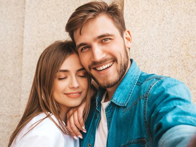 Niña hermosa sonriente y su novio guapo en ropa casual de verano. Foto gratis