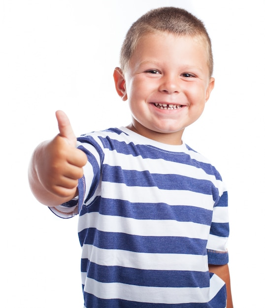 ni o peque o sonriendo con un pulgar arriba descargar On foto nino pequeno