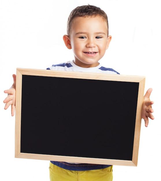 Ni o peque o sujetando una pizarra negra descargar fotos - Foto nino pequeno ...