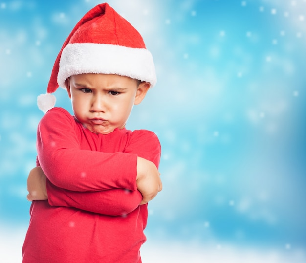 Ni o peque o triste llevando gorro de santa descargar - Foto nino pequeno ...