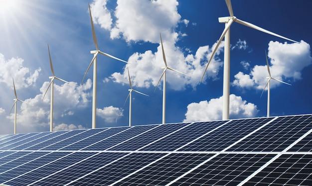 El panel solar del concepto de energía de energía limpia con turbina de viento y fondo de cielo azul Foto Premium