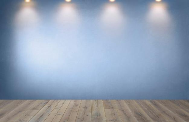 Pared azul con una fila de focos en una habitación vacía Foto gratis
