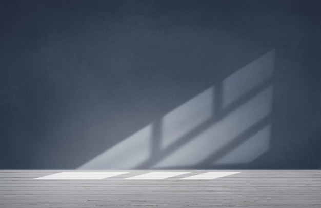 Pared azul en una habitación vacía con piso de concreto Foto gratis