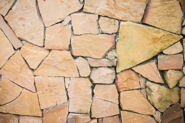 Pared de piedras irregulares descargar fotos gratis for Como alisar paredes irregulares