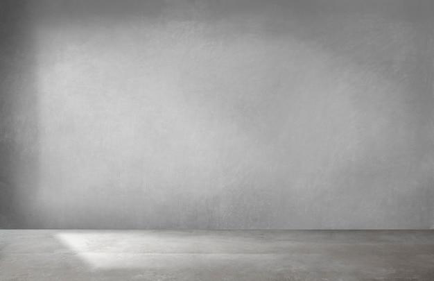 Pared gris en una habitación vacía con piso de concreto Foto gratis