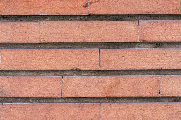 Pared de ladrillo . paredes de piedra envejecidas de la arena para el fondo de la textura y del diseño. Foto Premium