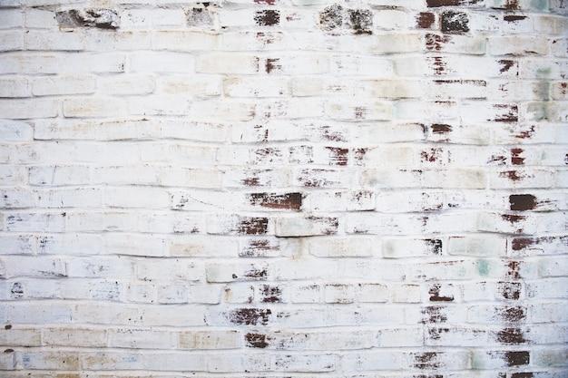 Pared de ladrillo resistida sucia Foto gratis