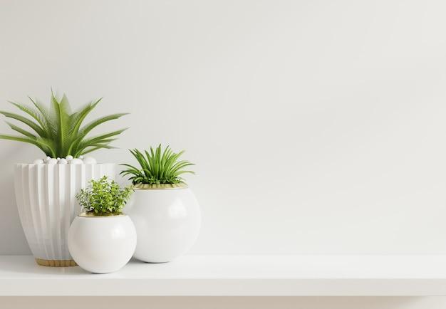 Pared de maqueta con plantas en estante Foto gratis