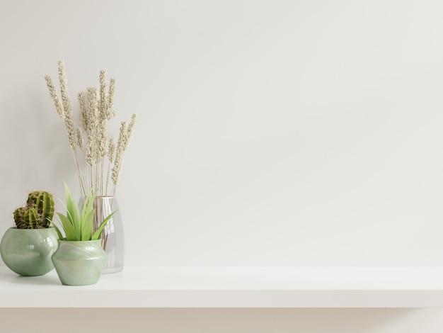 Pared de maqueta con plantas Foto gratis