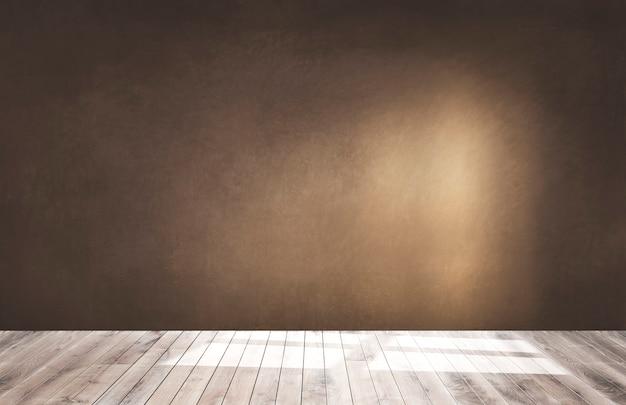 Pared marrón en una habitación vacía con piso de madera. Foto gratis