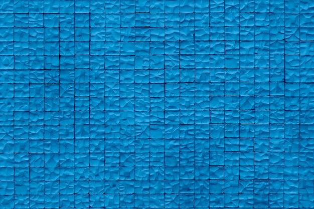 Pared de piedra . paredes de piedra envejecidas de la arena para el fondo de la textura y del diseño. color azul de moda del año. Foto Premium