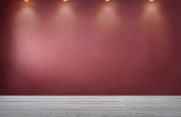 Pared roja con una fila de focos en una habitación vacía Foto gratis