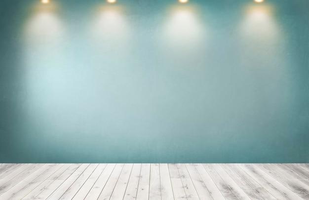 Pared verde con una fila de focos en una habitación vacía Foto gratis