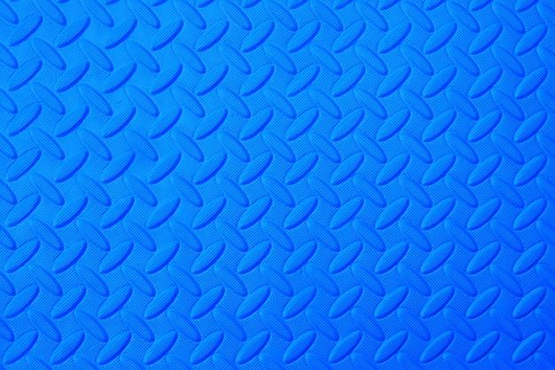 Patrón de goma de deslizamiento azul, fondo de textura de piso de plástico. Foto Premium
