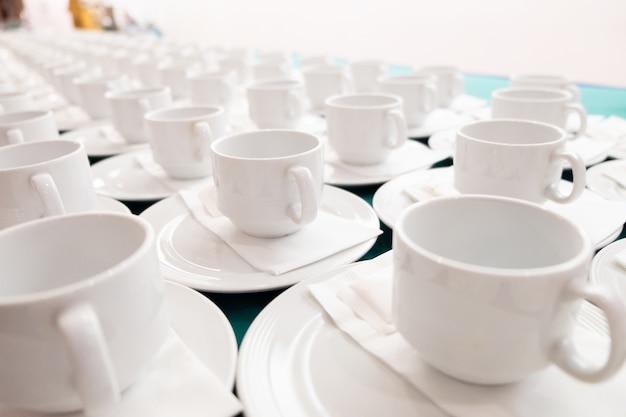 Patrón de la taza de café blanco. Foto Premium