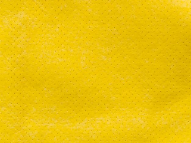 Pequeña tela amarilla punteada textil texturizada Foto gratis