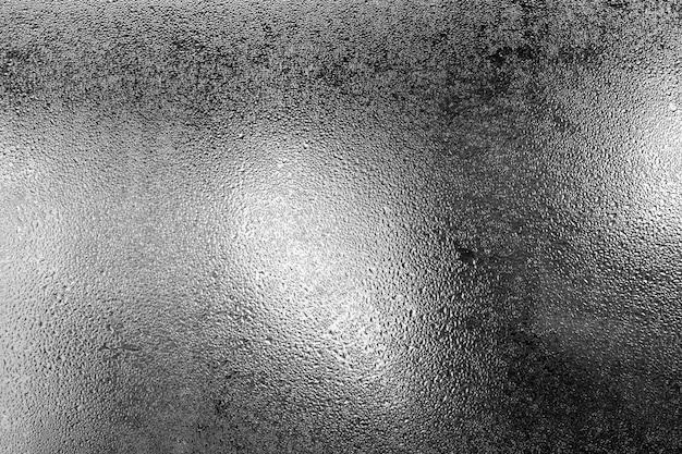Pequeño rocío hacia fuera del lado de la ventana por la mañana cerca de fondo. Foto Premium