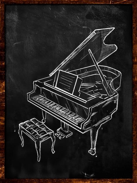 Piano de gran piano en la pizarra de la música Foto gratis