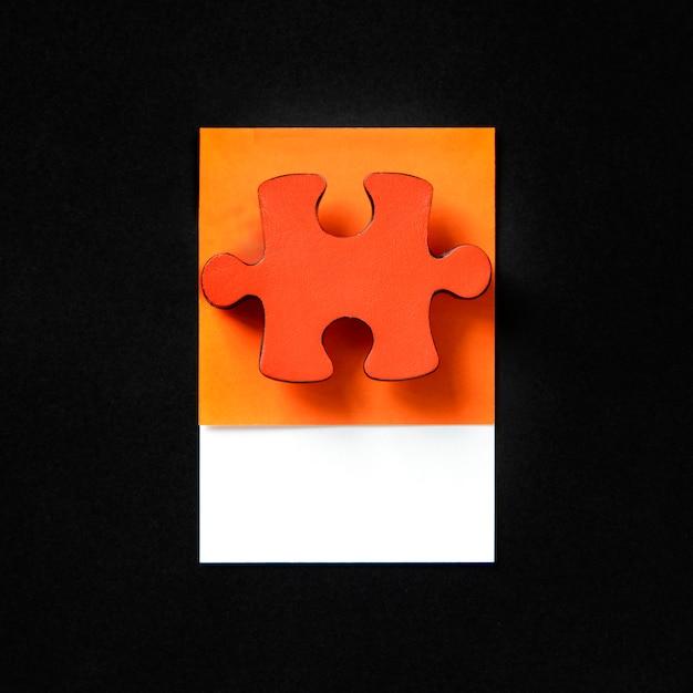 Pieza de puzzle juego de rompecabezas naranja Foto gratis