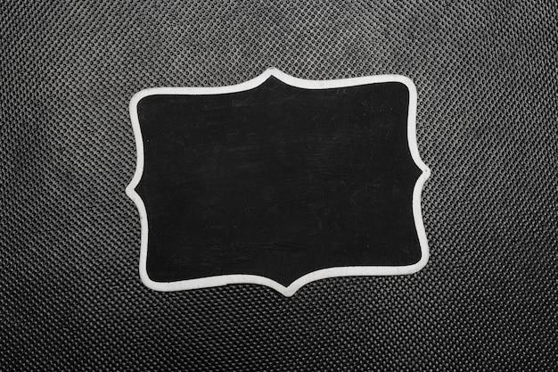 Piezas de papel negro simulacro vista superior sobre fondo negro Foto Premium