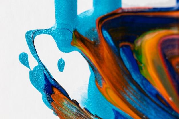 Pintura naranja y azul mezclada manchada Foto gratis