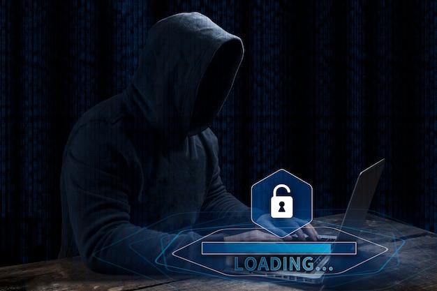 Pirata informático de ordenador anónimo sobre fondo digital abstracto. rostro oscuro obscurecido en máscara y capucha. Foto Premium