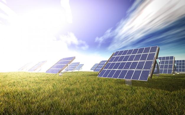 Placas solares en un prado Foto gratis