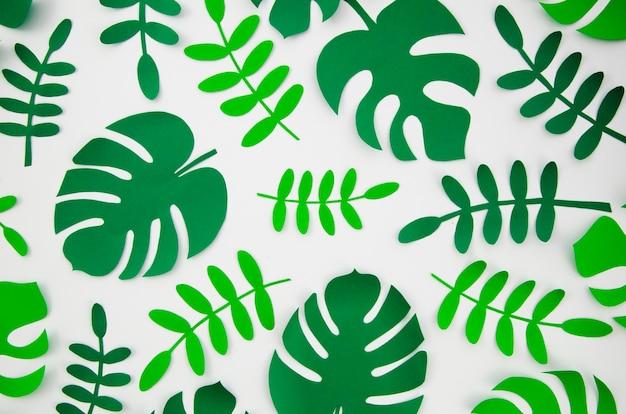 Plantas monstera tropicales al estilo de papel cortado Foto gratis