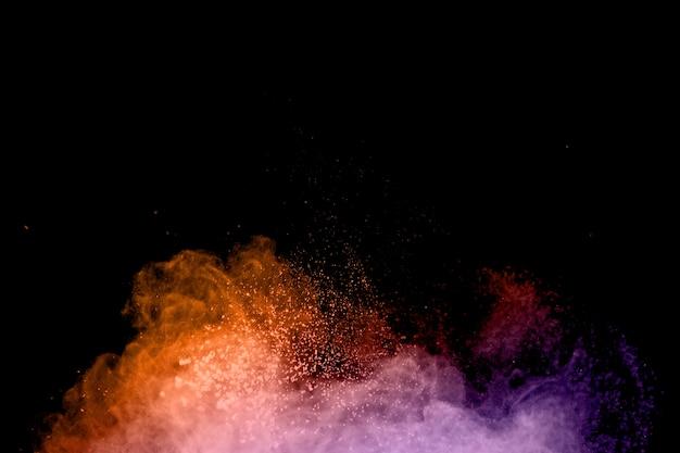 Polvo volador de colores en remolinos Foto gratis