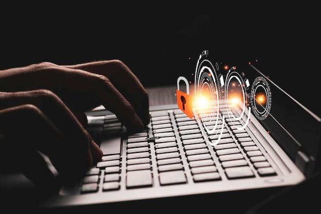 Presione a mano escribiendo en el teclado para desbloquear contraseñas o acceder a la computadora portátil. concepto de seguridad cibernética. Foto Premium