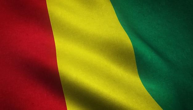 Primer plano de la bandera ondeante de guinea con texturas interesantes Foto gratis